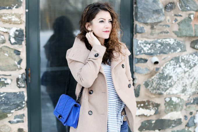 denim outfit: striped peplum top, camel wool coat, taupe ankle boots