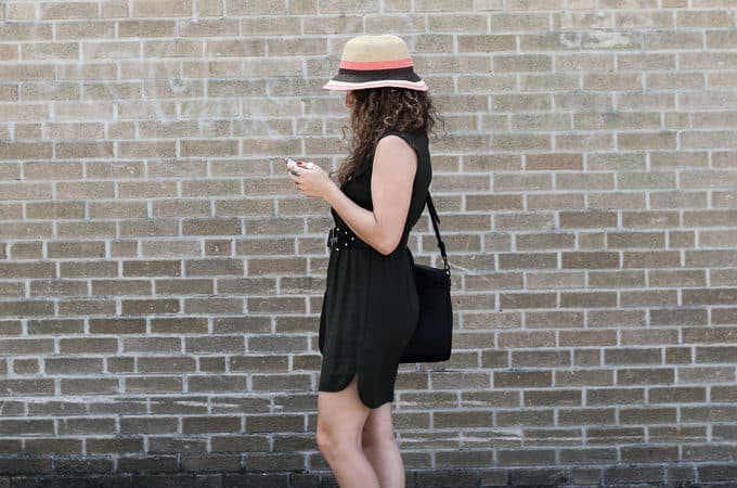 belted olive dress with a striped hat and lace up flats
