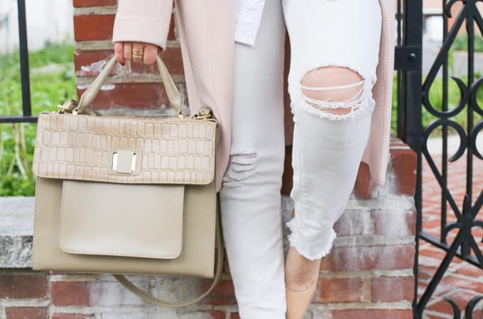 neutral spring style: pairing a pink jacket with distressed white jeans