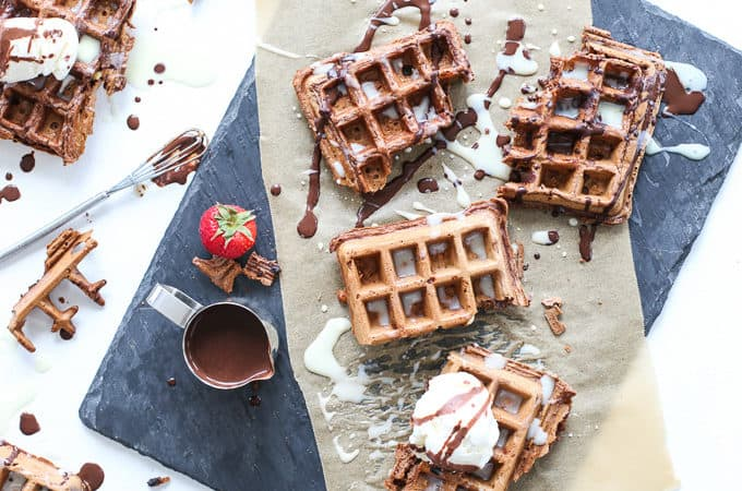 Chocolate waffles filled with white chocolate chips and drizzled with semi-sweet and white chocolate