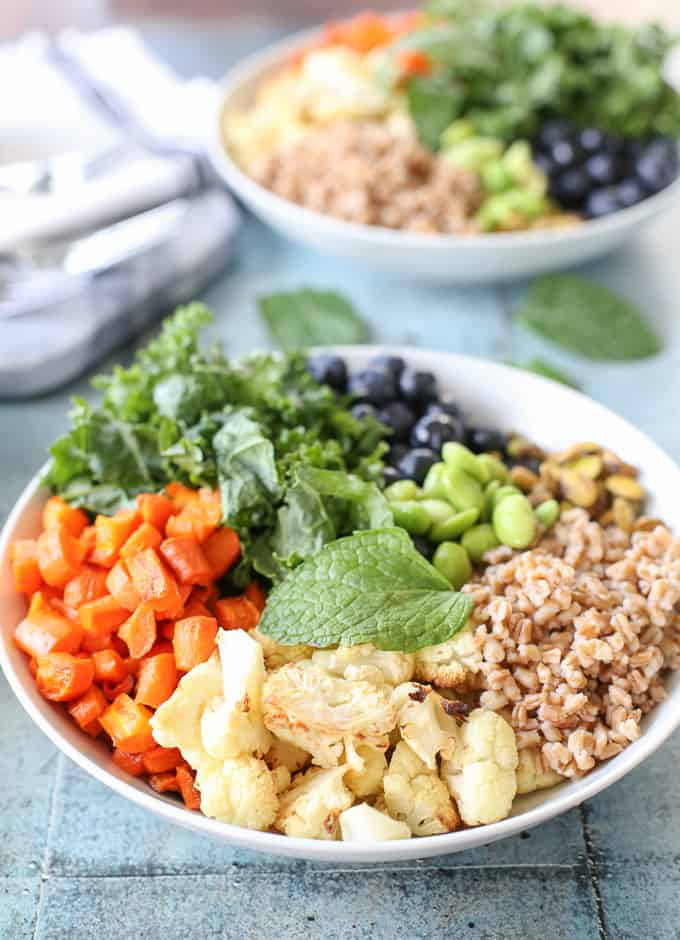 A healthy & colorful salad: roasted cauliflower and carrots, kale, blueberries, edamame, wheat berries and a tahini dressing