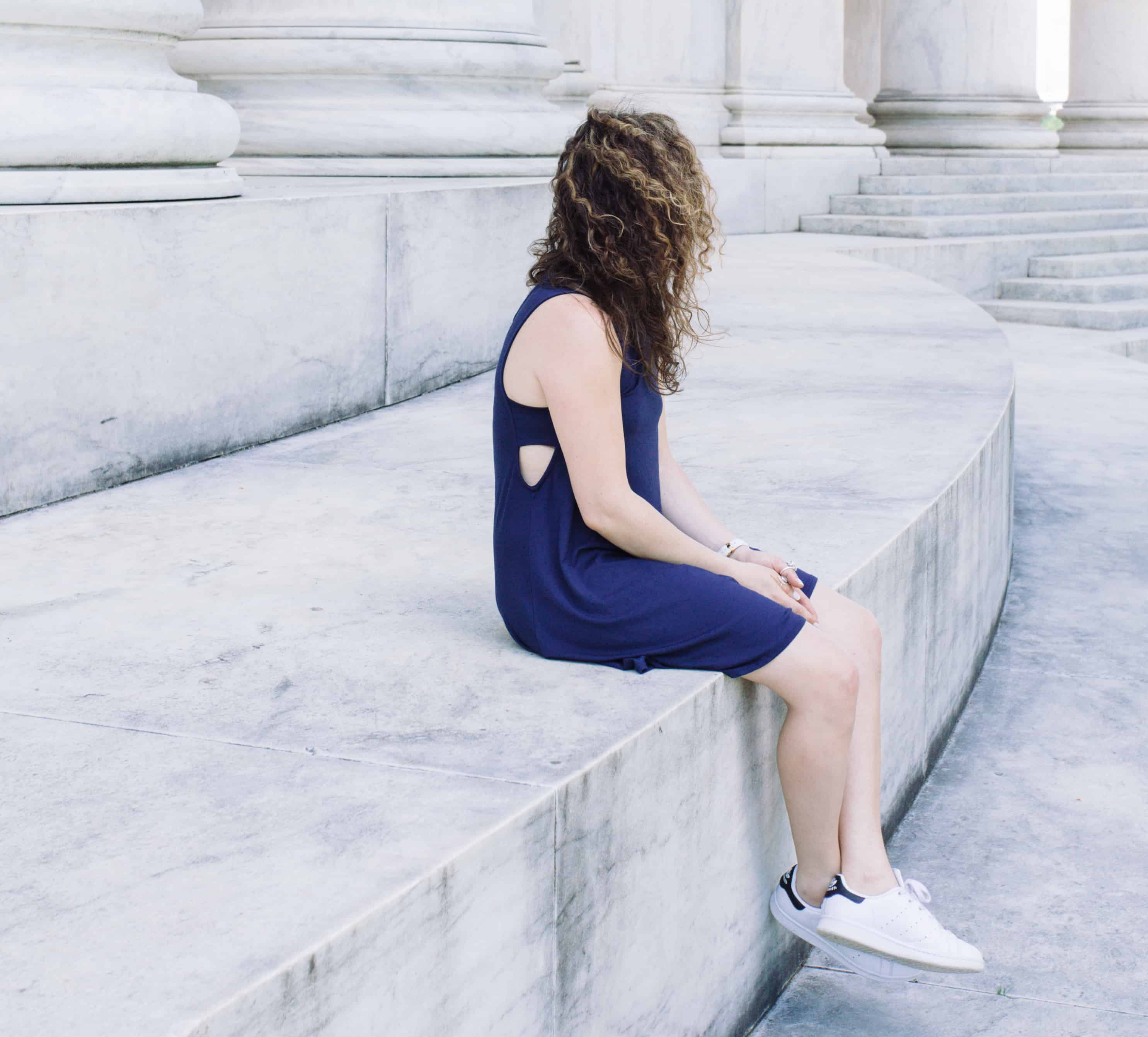 Summer casual: navy dress and white Adidas sneakers
