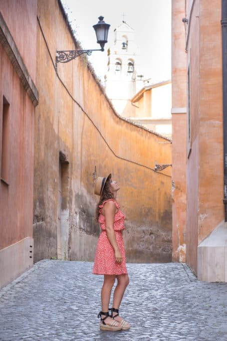 exploring Italy in a floral dress and boater hat