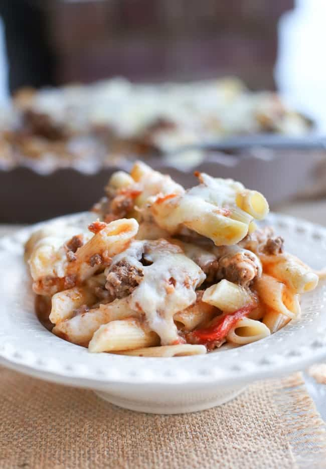 Cheesy bechamel filled pasta bake with tomatoes and beef