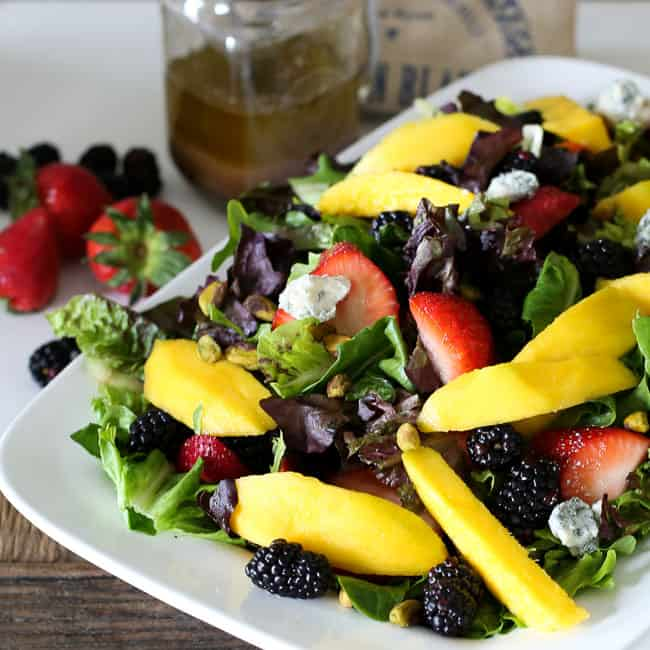 mango berry salad with pistachios and coconut dressing