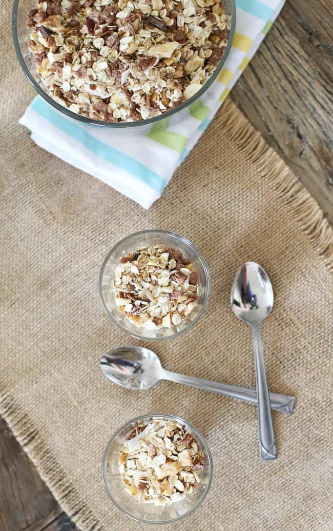 Homemade mixed cereal with granola, oats, crisp rice cereal and dried fruits