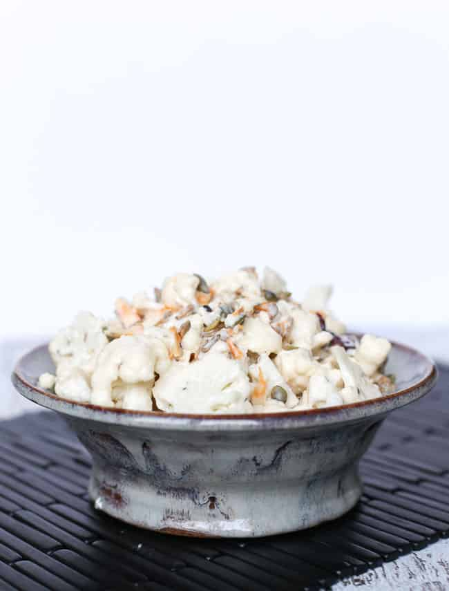 a lettuceless cauliflower salad with cranberries, sunflower seeds and a tangy dressing
