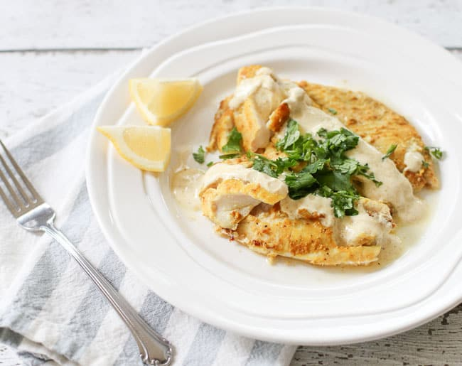 Cumin curry tilapia filets served with a cumin-curry yogurt sauce with a touch of coriander