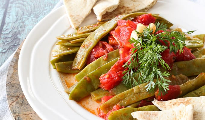 Sauteed garlic tomato green beans with cilantro