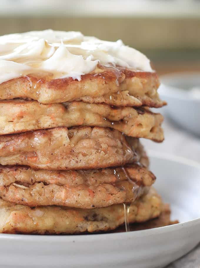 carrot cake pancakes with pineapple, coconut and nuts - served with cream cheese spread