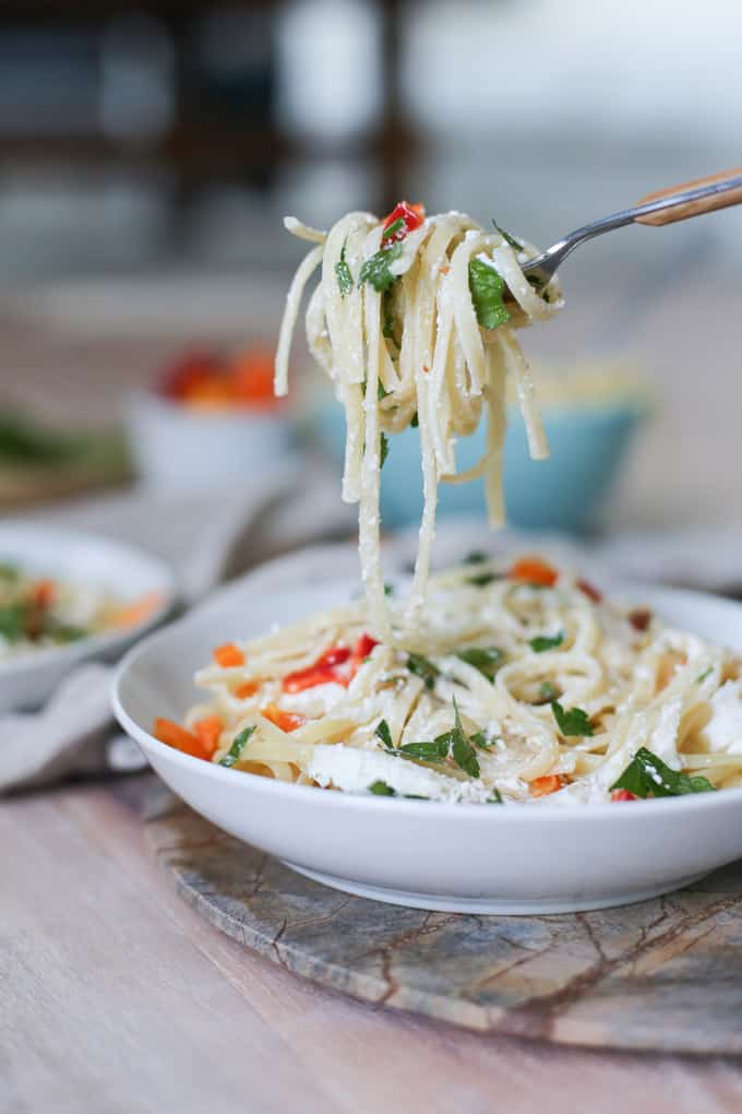Easy recipe for veggie pasta! Goat and feta cheese linguine with sweet peppers, parsley and pecans!