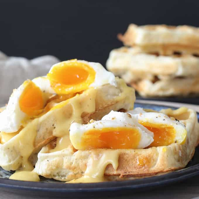 Savory breakfast waffles with Herbes de Provence, poached eggs and hollandaise sauce