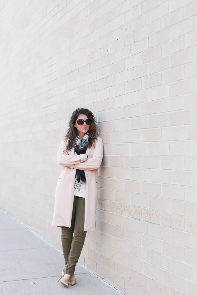 blush coat over crochet top, plaid scarf and olive denim