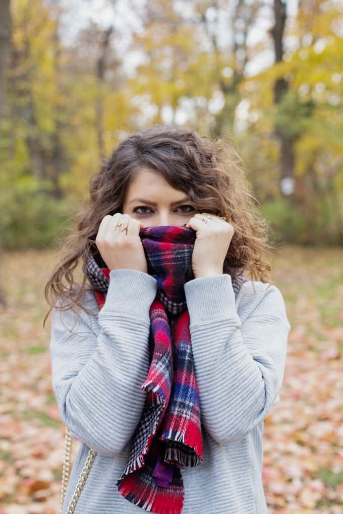 perfect fall outfit: red plaid scarf, red crossbody, over the knee boots and a gray sweater