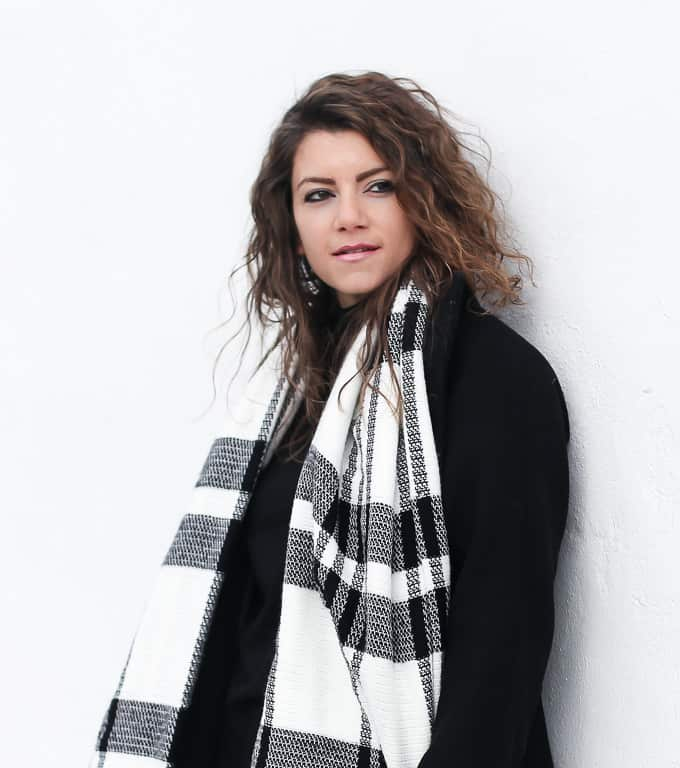 flared denim with a black and white plaid scarf and burgundy booties