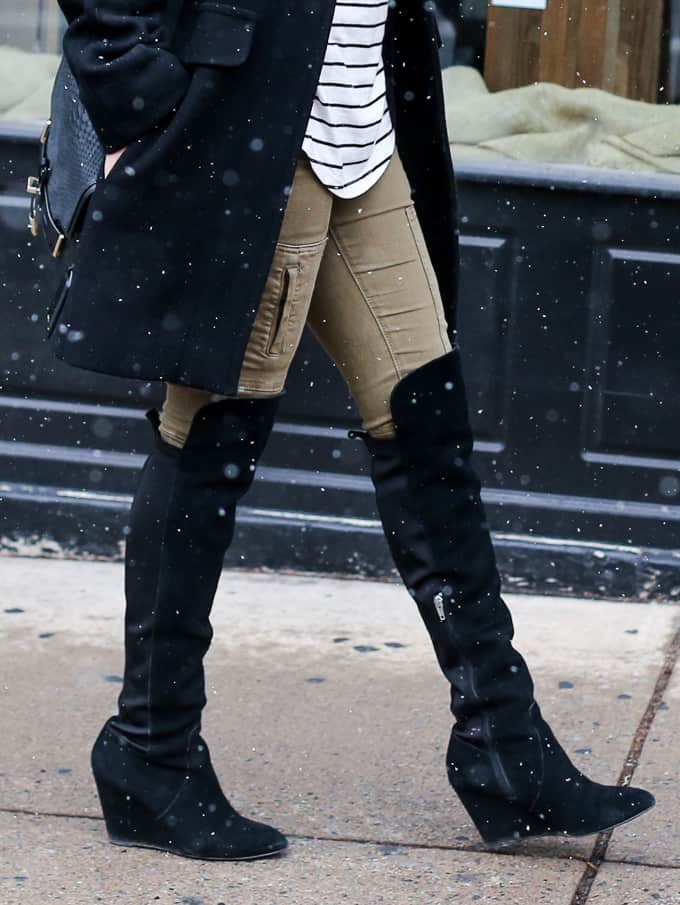 snow day winter outfit: thick winter coat, olive denim, striped top and a pair of suede boots