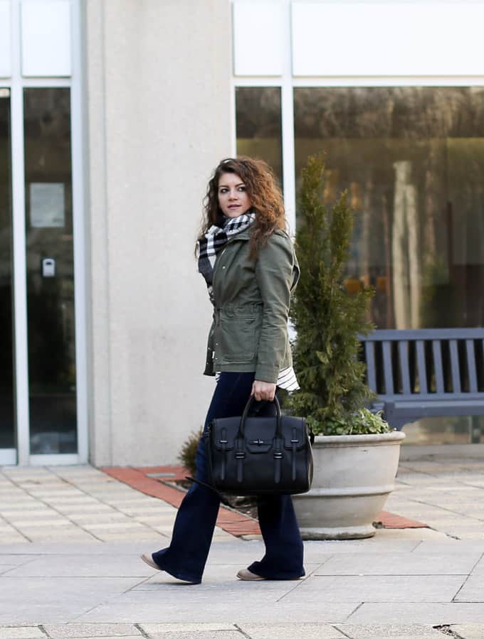 flares, plaid scarf and an olive jacket