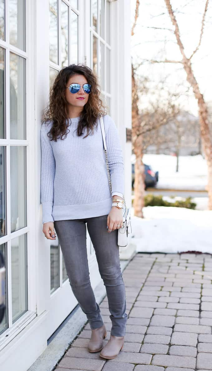pastels in winter: blue sweater with gray denim and taupe boots