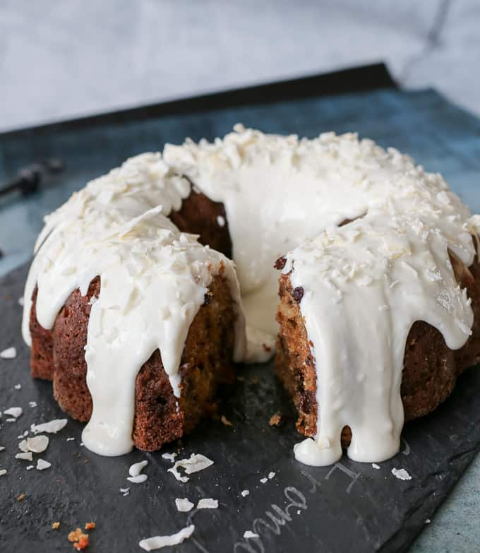 macerated currant carrot cake with coconut lime icing