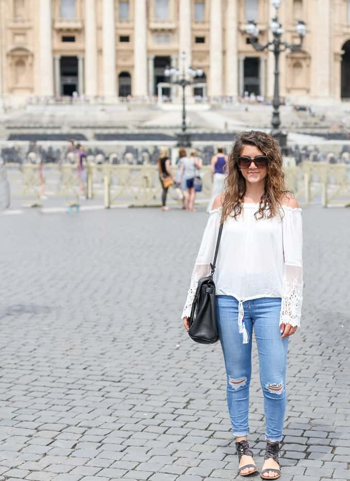 Rome outfit: light blue denim, off the shoulder crochet top and black satchel