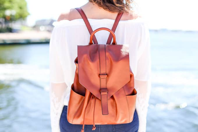 leather backpack and flared denim