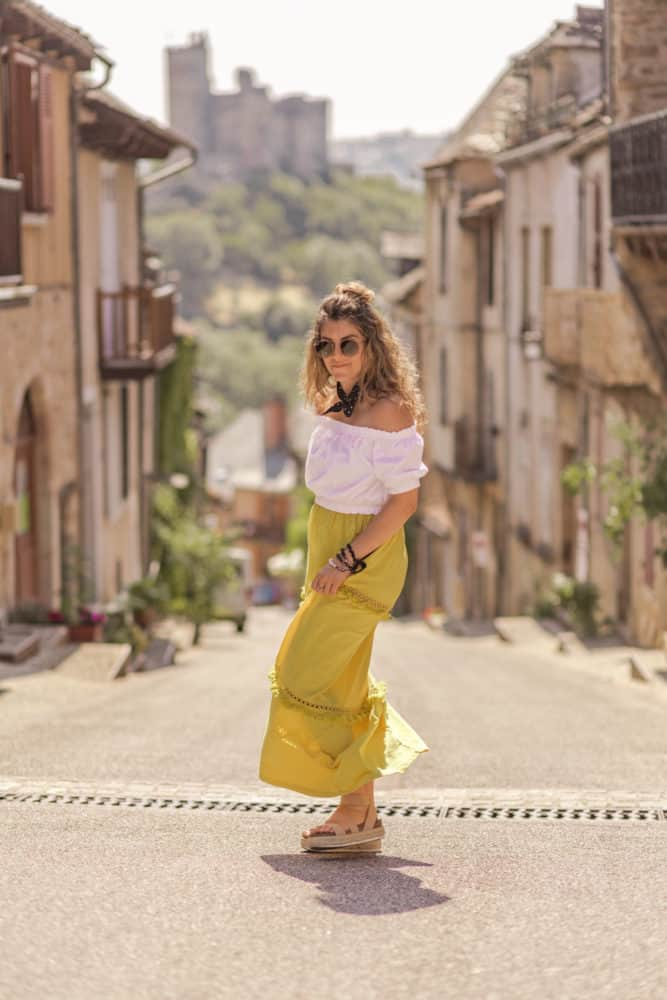 girl in yellow skirt posing for a photo