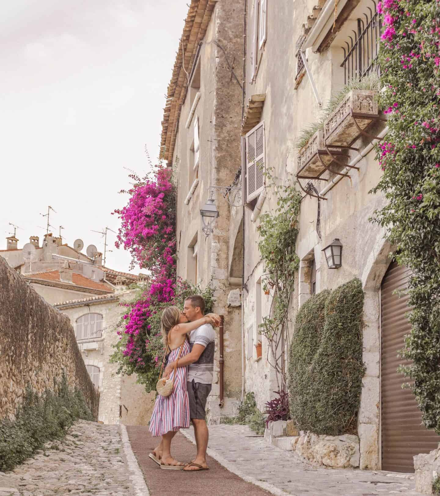 woman and man kissing in an old French village