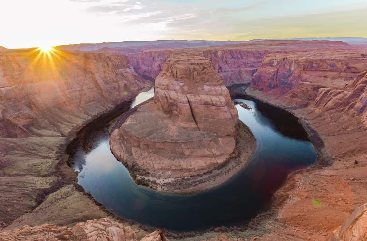 view of a sunset over Horseshoe Bend in Page Arizona