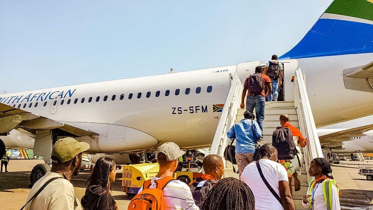 people boarding a plane outside
