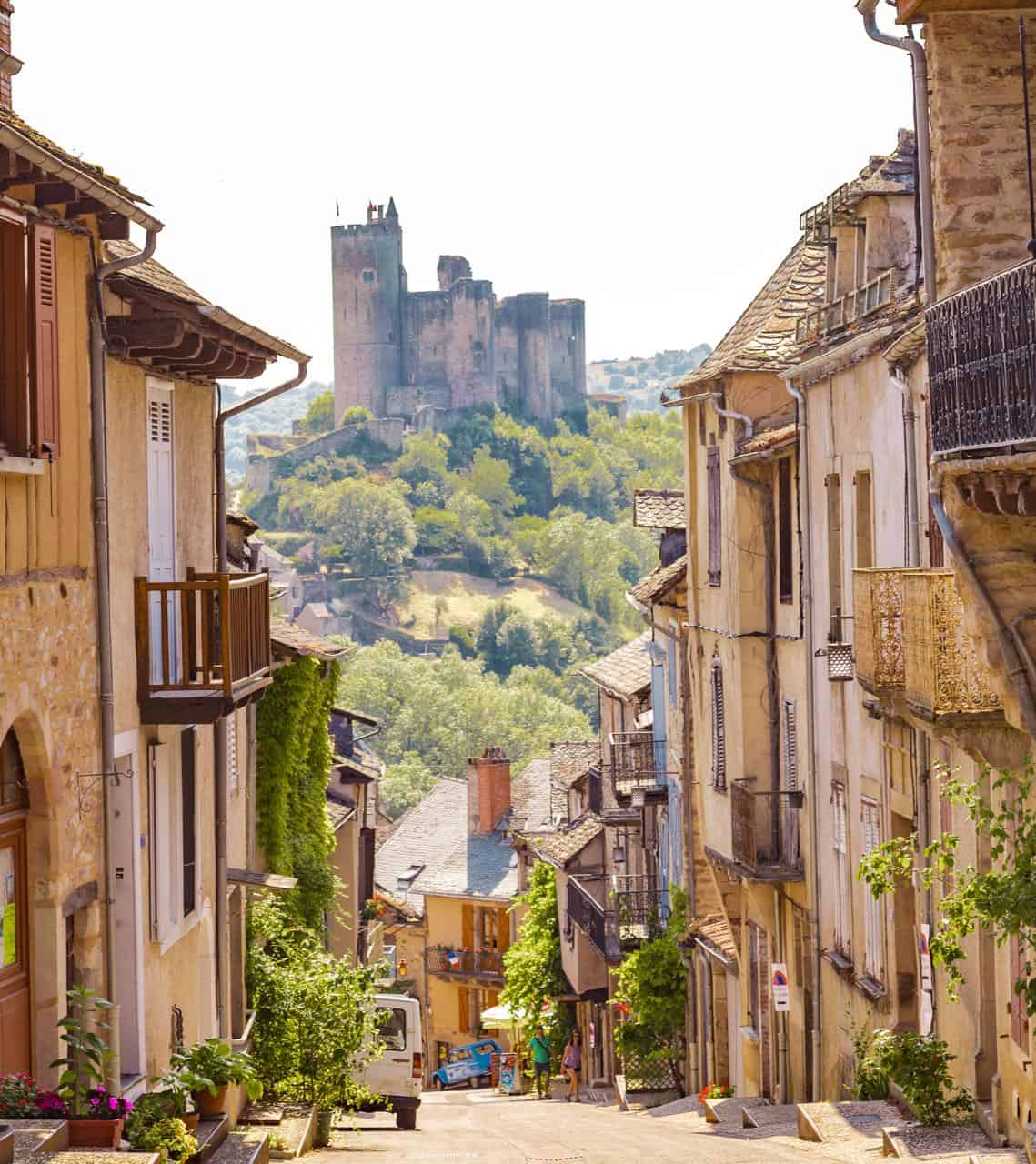 southwest France town called Najac with a castle in the distance