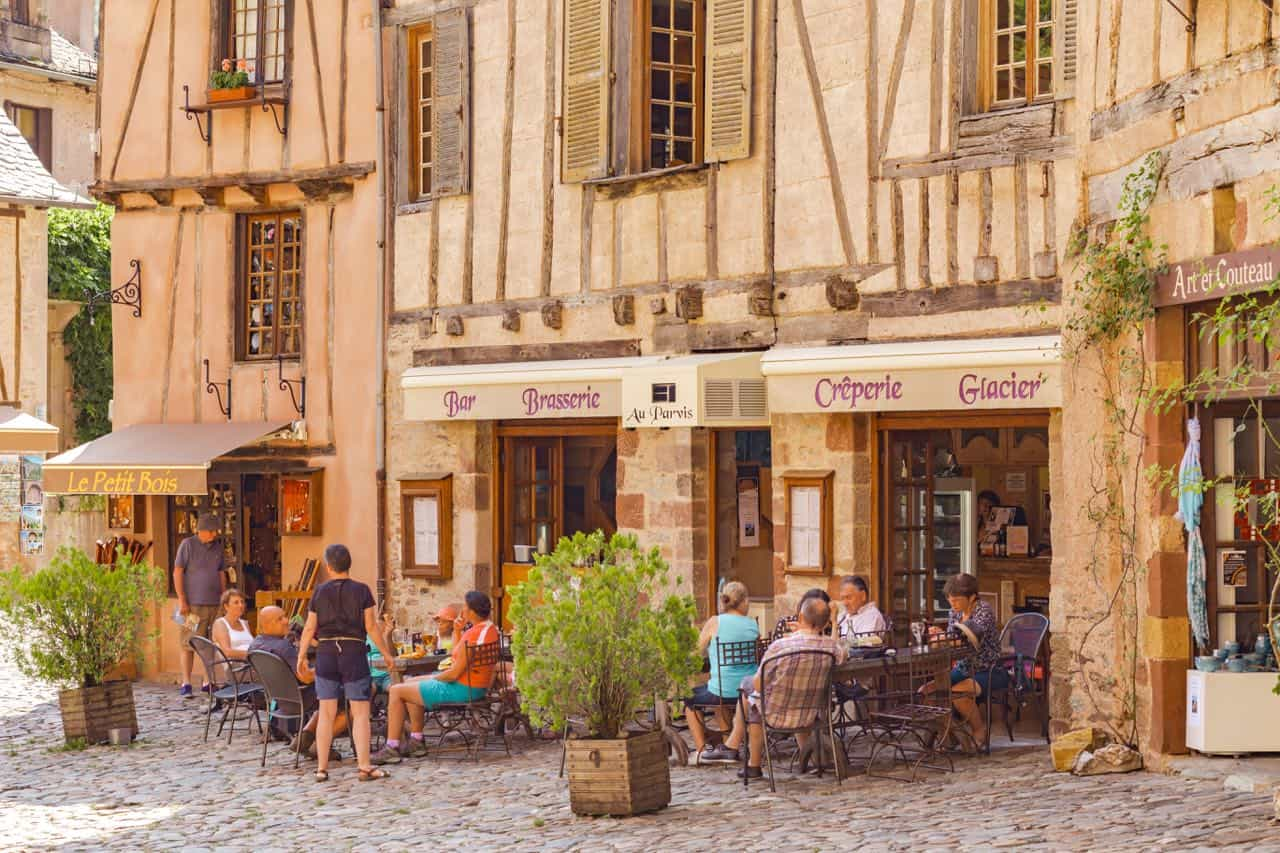 French cafe with people sitting in it