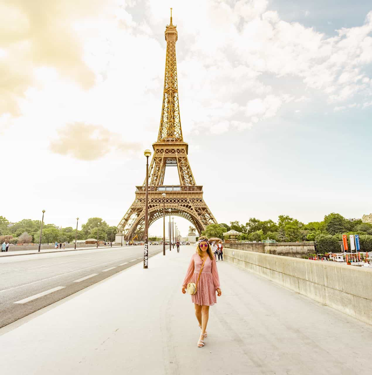 woman walking the street in  front of the Eiffel Tower