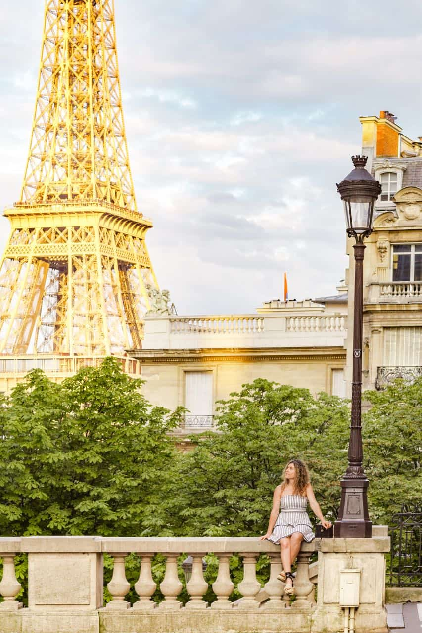Eiffel Tower and French building with girl in the front